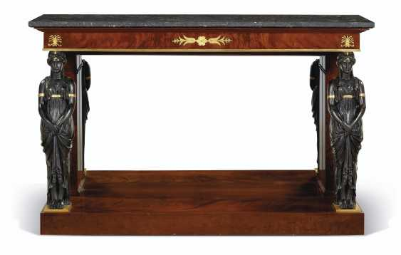 A FRENCH ORMOLU-MOUNTED PARCEL-GILT AND BRONZED MAHOGANY CONSOLE - photo 2