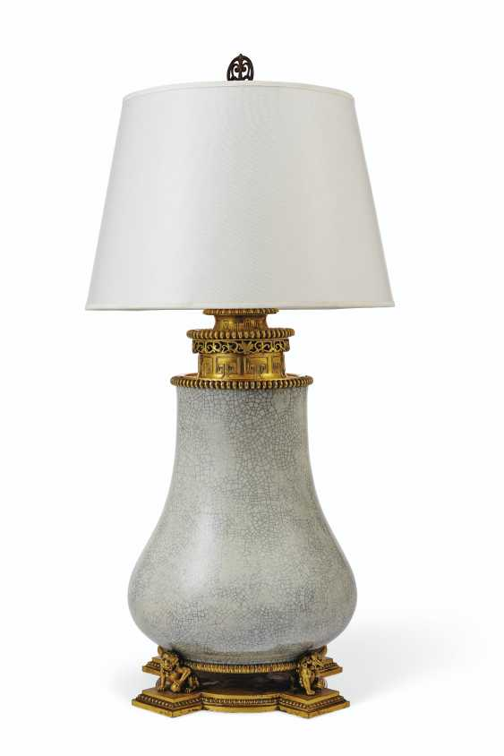 A LARGE AMERICAN GILT-BRONZE AND CHINESE CELADON CRACKLE GLAZE PORCELAIN TABLE LAMP - photo 1