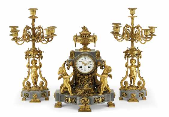 A FRENCH ORMOLU AND BLEU TURQUIN MARBLE THREE-PIECE CLOCK GARNITURE - photo 1