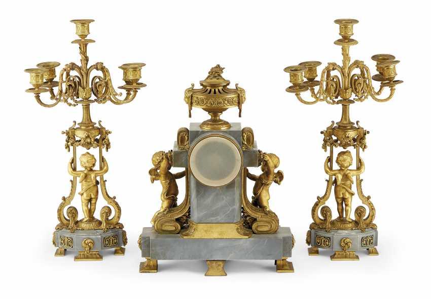 A FRENCH ORMOLU AND BLEU TURQUIN MARBLE THREE-PIECE CLOCK GARNITURE - photo 2