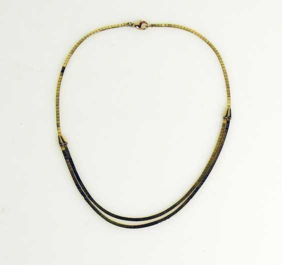 a necklace - photo 1