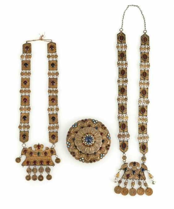 Two silver, partially fire-gilded chains and a round jewelry pectoral - photo 1