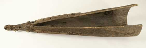 Bow of a dugout canoe made of wood - photo 2