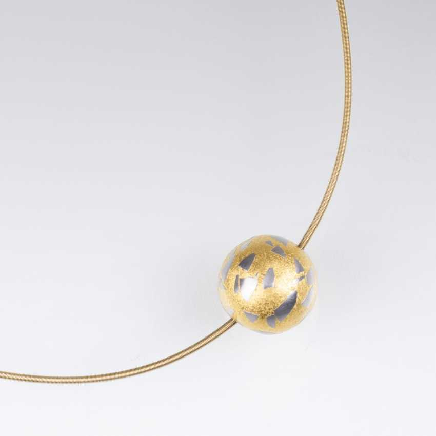 Niessing was founded in 1873 in Westphalia. Platinum-Gold-bullet-pendant 'Terrazzo' with Gold-Ripe - photo 1