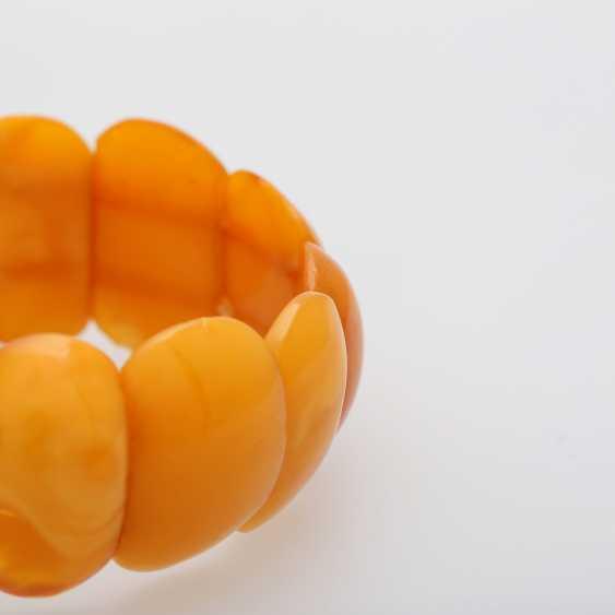 Bracelet made of bright amber elements - photo 4