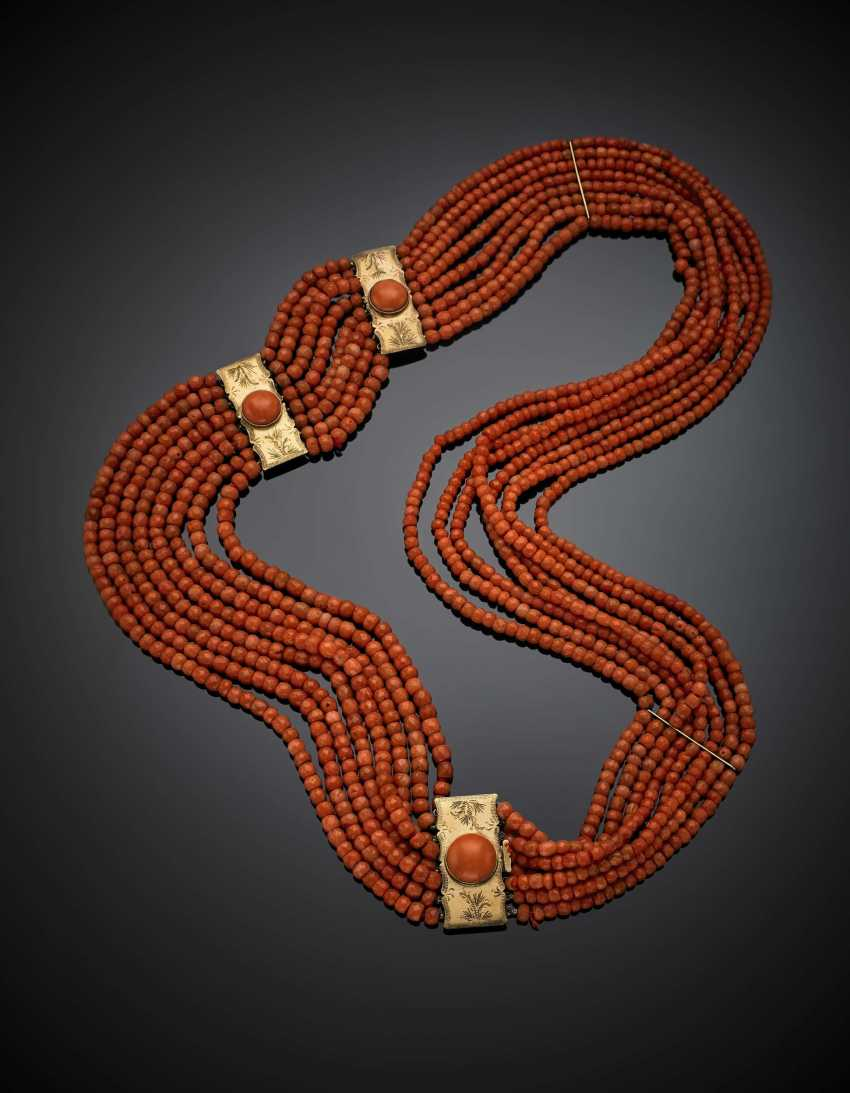 Eight strand orange coral faceted bead necklace with 9K chiseled gold clasp and spacers - photo 1