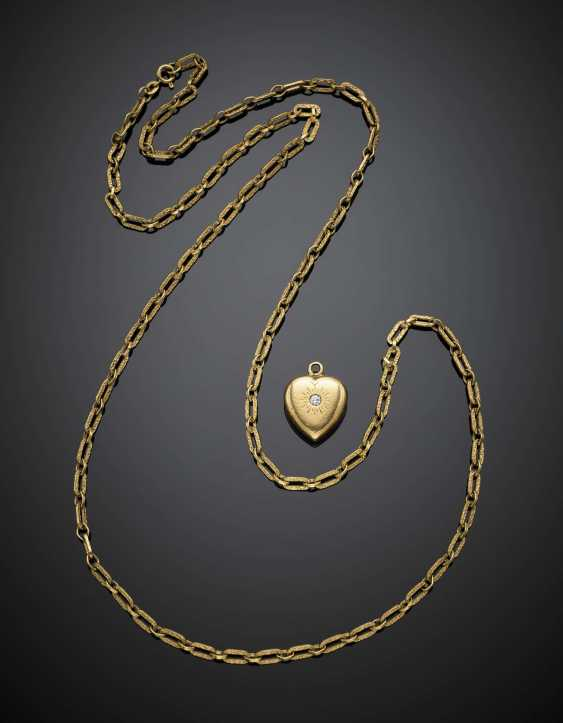 Yellow gold lot comprising a textured chain and a heart shape pendant accented with one diamond - photo 1