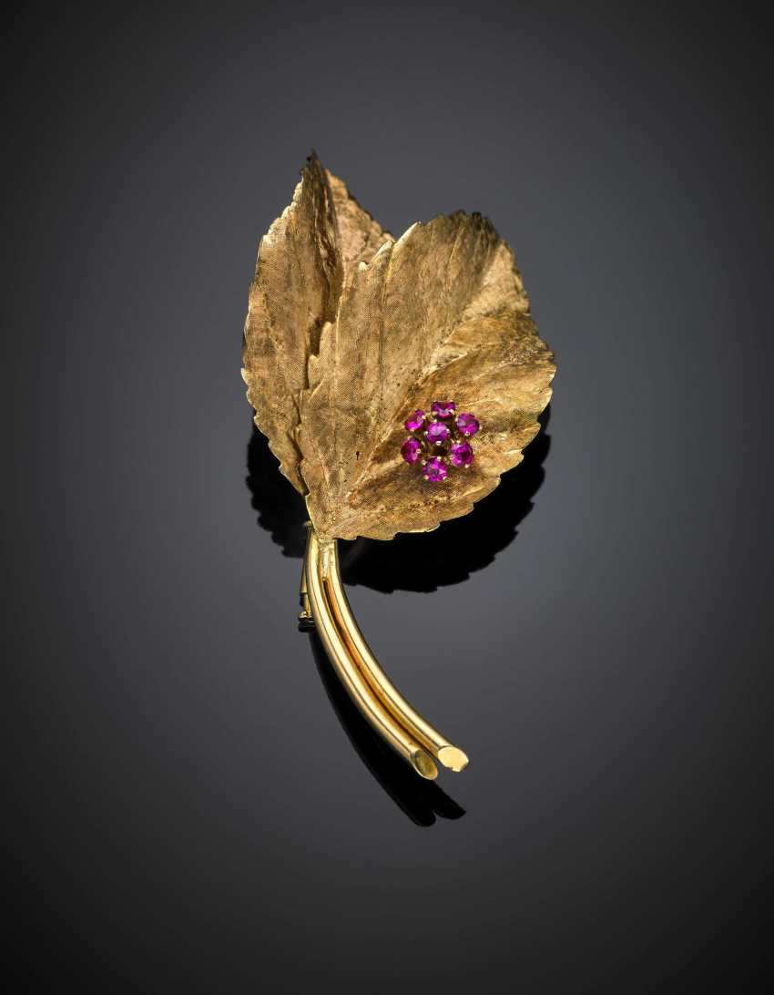 Yellow partly glazed gold leaf brooch accented with synthetic rubies - photo 1