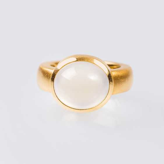 Modern gold ring with moonstone - photo 1
