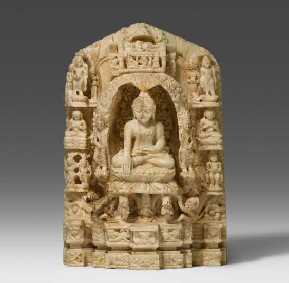 Small stone relief with scenes from the life of Buddha