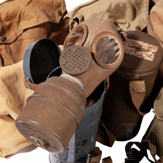 Ten gas masks with a container, different nations, World War II - photo 2