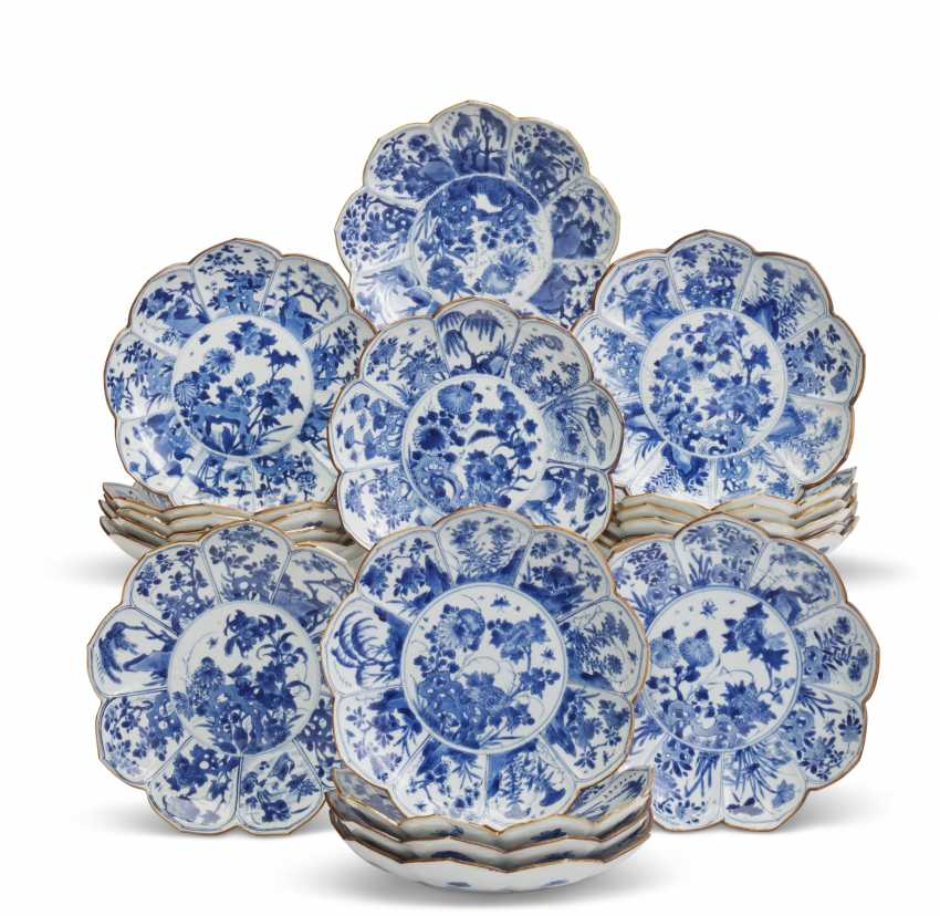 A SET OF NINETEEN CHINESE MOLDED BLUE AND WHITE 'LOTUS' DISHES - photo 1