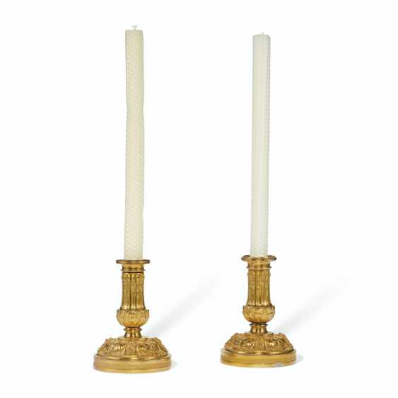 A PAIR OF LOUIS XVI ORMOLU CANDLESTICKS - photo 1