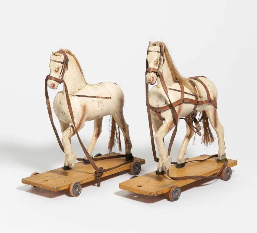 2 toy horses on castors - photo 1
