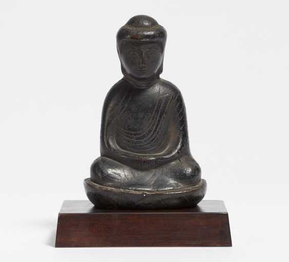 Relief figure of a Buddha in meditation on a lotus base - photo 1