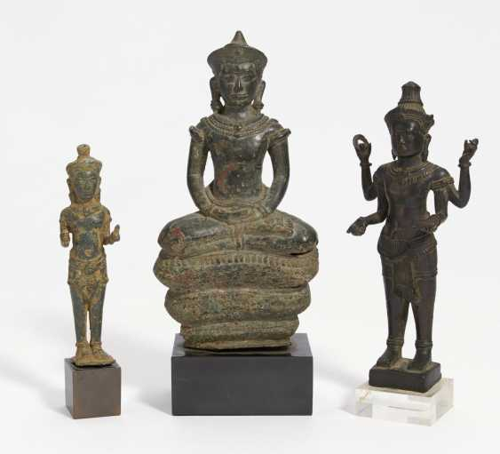 Two standing figures and Buddha on a snake throne - photo 1