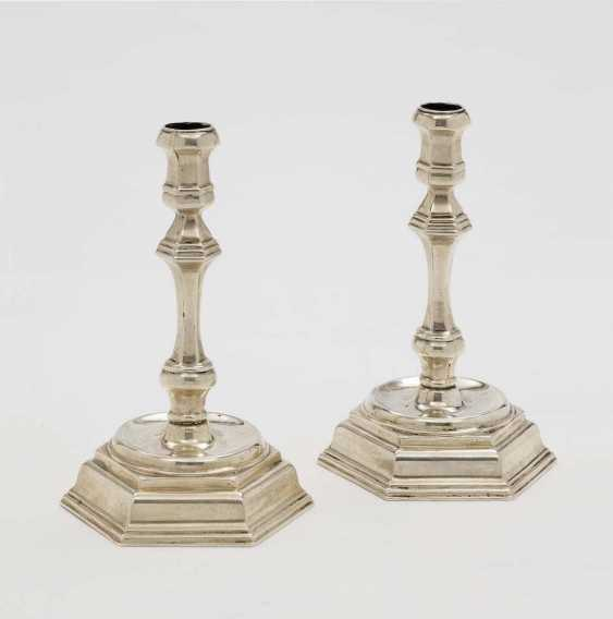 A PAIR of CANDLESTICKS of Baroque style - photo 1
