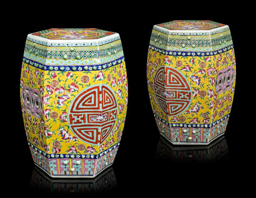 A PAIR OF CHINESE YELLOW-GROUND FAMILLE ROSE HEXAGONAL GARDEN SEATS - photo 1