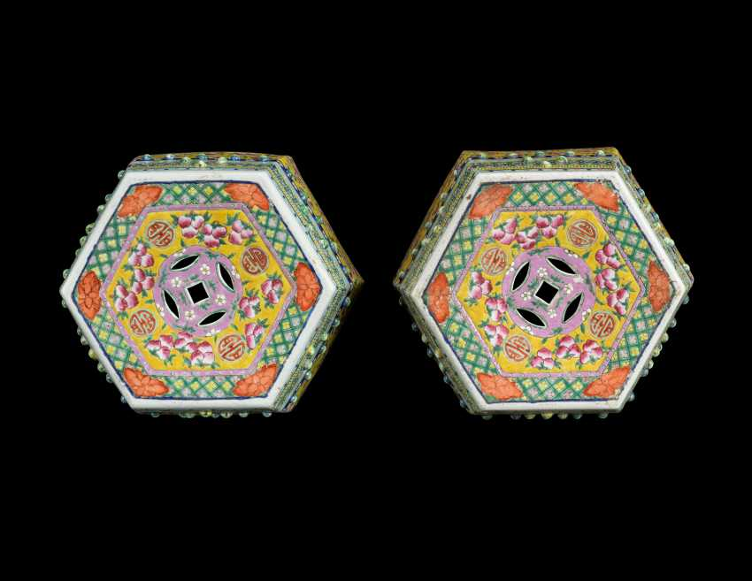 A PAIR OF CHINESE YELLOW-GROUND FAMILLE ROSE HEXAGONAL GARDEN SEATS - photo 2