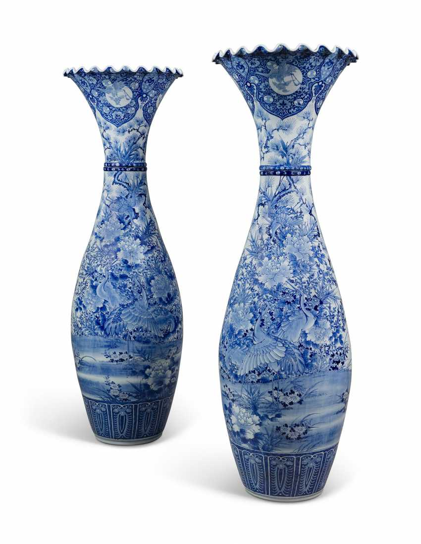 A LARGE PAIR OF JAPANESE BLUE AND WHITE FLARED VASES - photo 1