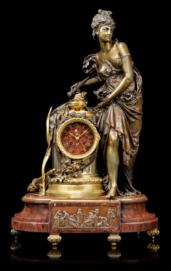 A FRENCH ORMOLU AND PATINATED-BRONZE MOUNTED FIGURAL MANTEL CLOCK - photo 1