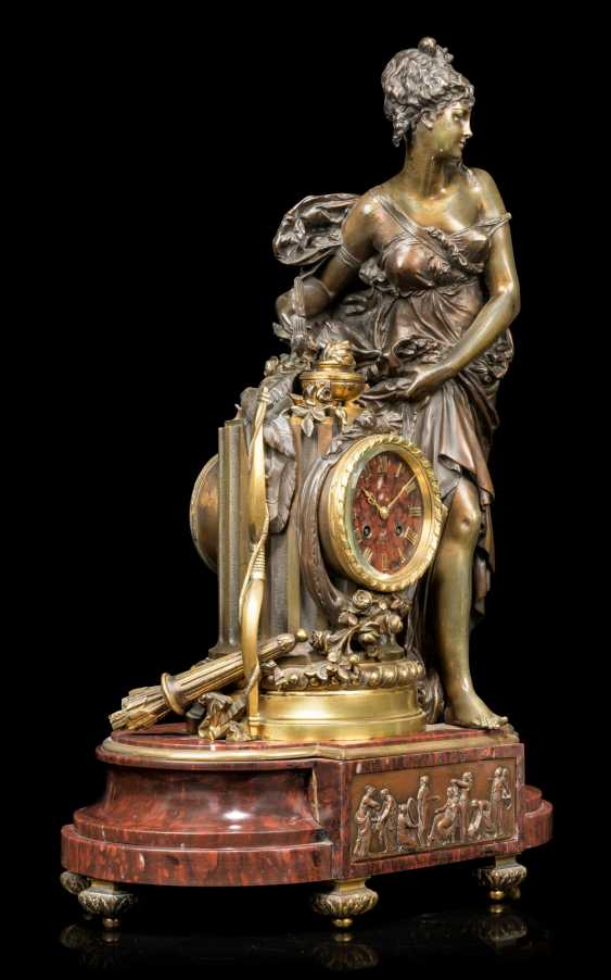 A FRENCH ORMOLU AND PATINATED-BRONZE MOUNTED FIGURAL MANTEL CLOCK - photo 2