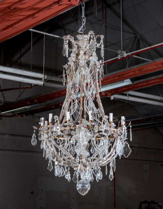A GILT-METAL CUT, MOULDED AND BEADED-GLASS TWELVE-LIGHT CHANDLIER - photo 1