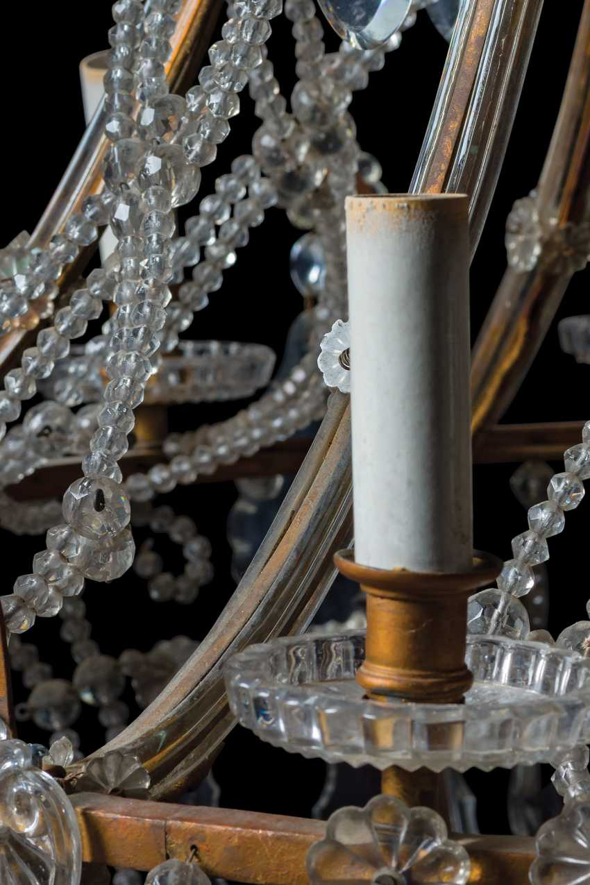 A GILT-METAL CUT, MOULDED AND BEADED-GLASS TWELVE-LIGHT CHANDLIER - photo 5