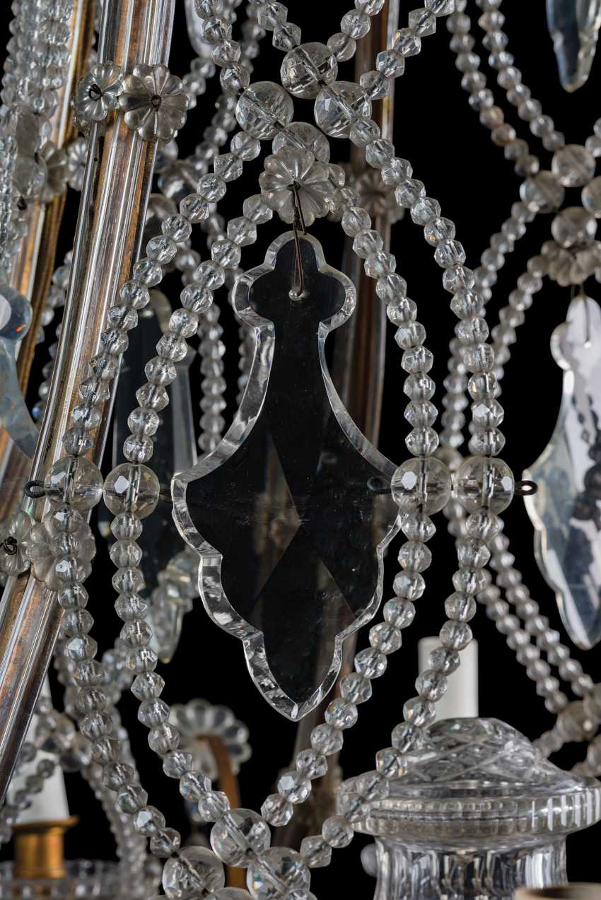 A GILT-METAL CUT, MOULDED AND BEADED-GLASS TWELVE-LIGHT CHANDLIER - photo 6