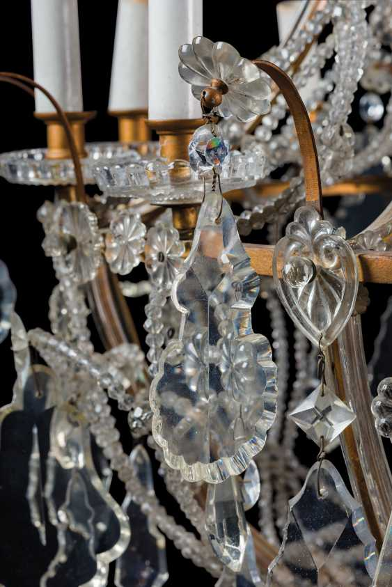 A GILT-METAL CUT, MOULDED AND BEADED-GLASS TWELVE-LIGHT CHANDLIER - photo 7