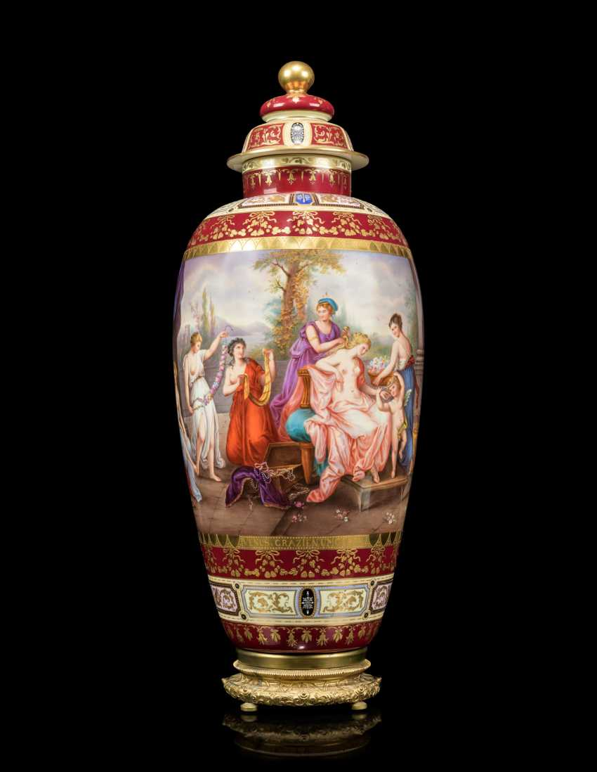 A PAIR OF LARGE VIENNA-STYLE PORCELAIN CLARET-GROUND VASES AND COVERS - photo 2