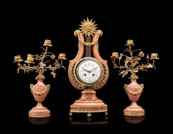A FRENCH ORMOLU-MOUNTED AND 'JEWELED' PINK MARBLE THREE-PIECE CLOCK GARNITURE - photo 1