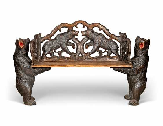 A SWISS 'BLACK FOREST' CARVED AND STAINED WALNUT BENCH - photo 1