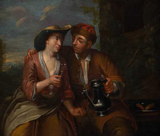YOUNG COUPLE DRINKING WINE - photo 1