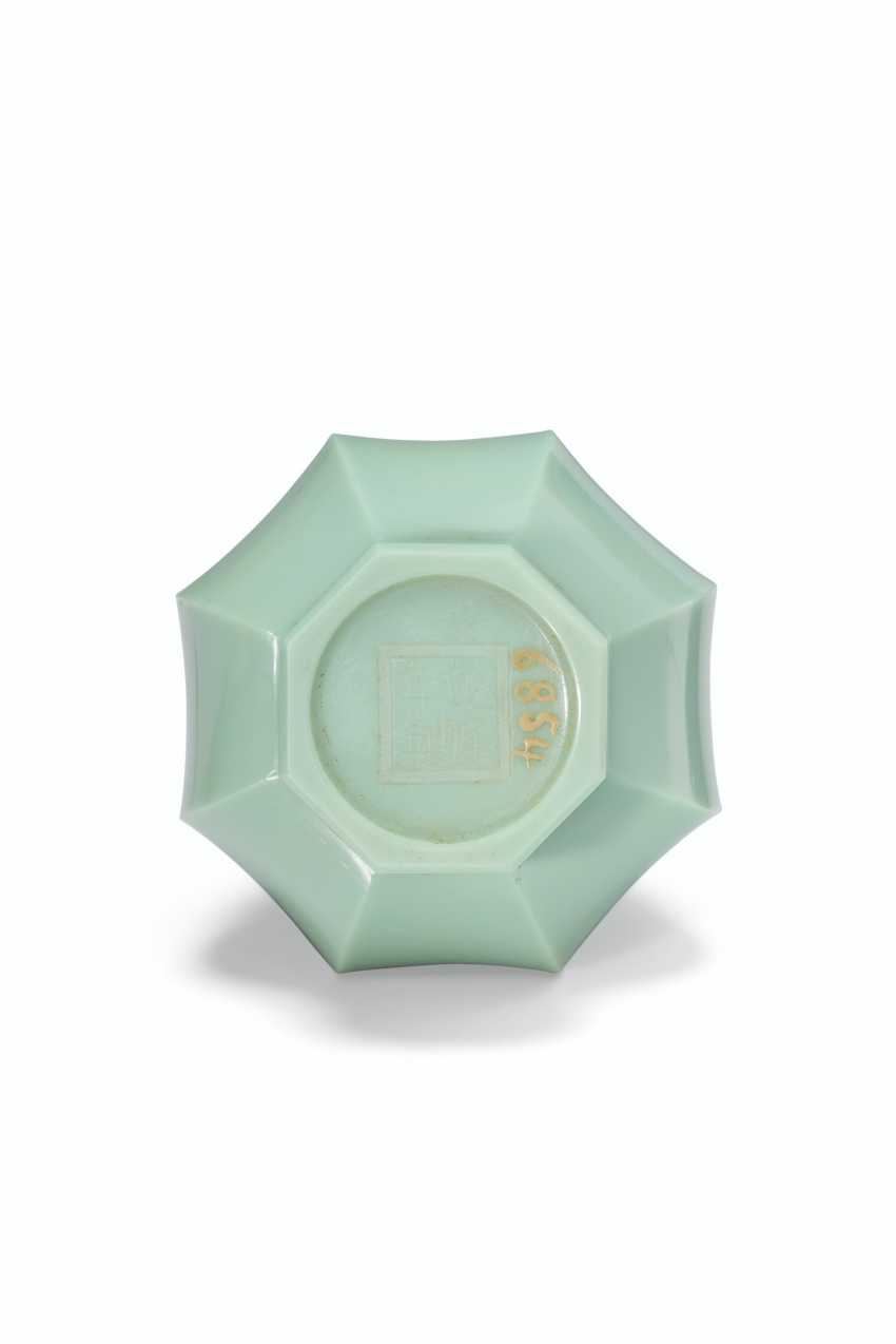 A SMALL OPAQUE GREEN GLASS FACETED BOTTLE VASE - photo 2