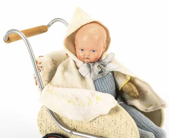 """Blond heads"" in a doll's pram - photo 2"