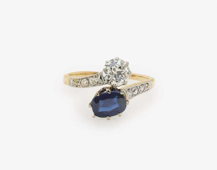 VIS A VIS RING DECORATED WITH DIAMONDS AND A SAPPHIRE - photo 1