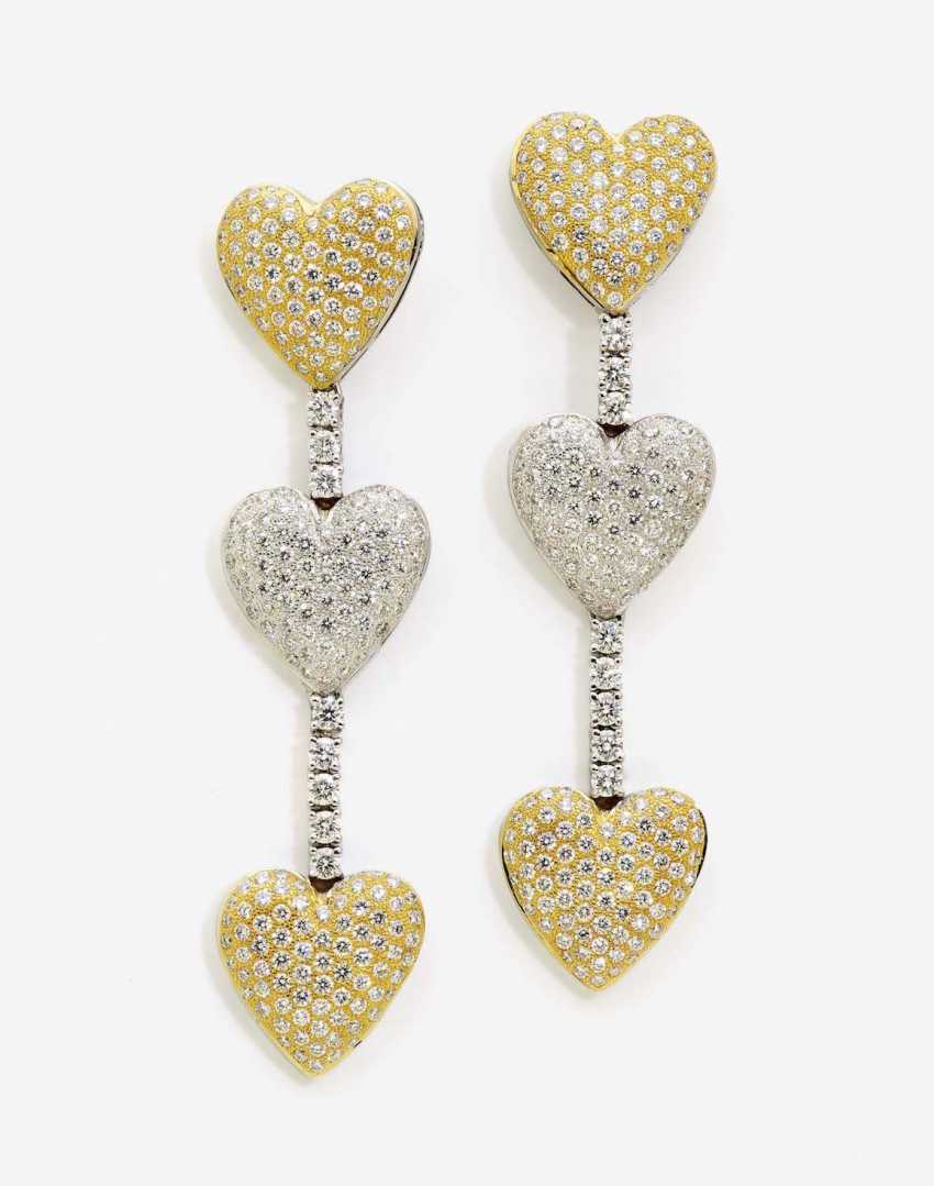 A PAIR OF HEART SHAPED STUD PIN HANGER IS DECORATED WITH DIAMONDS - photo 1
