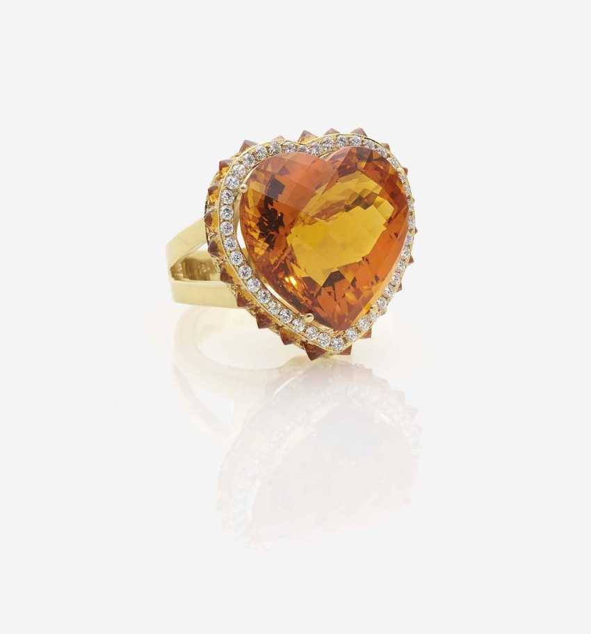A MODIFIED COCKTAIL RING DECORATED WITH A HEART-SHAPED MADEIRA CITRINE - photo 1