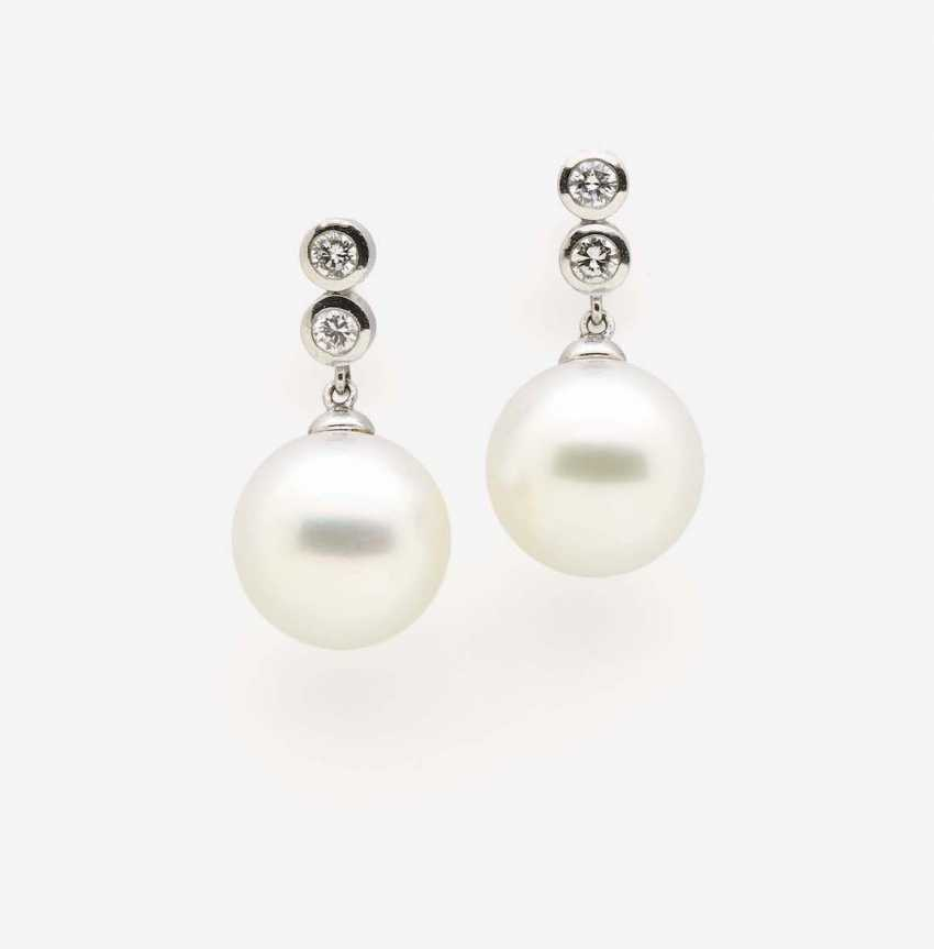 A PAIR OF SOUTH SEA CULTURED PEARL EARRINGS WITH DIAMONDS - photo 1