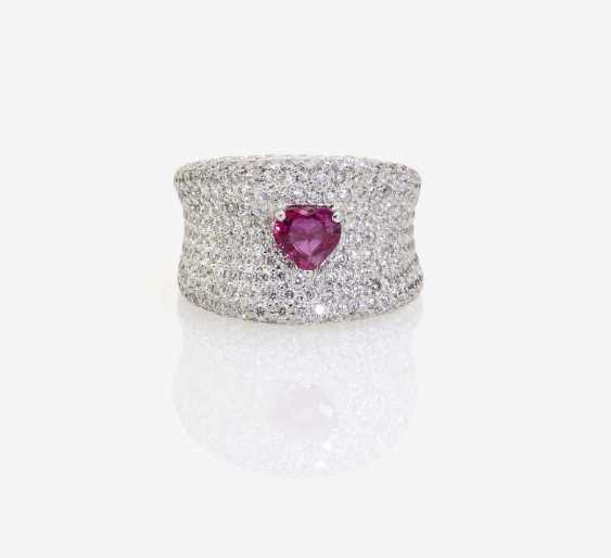 A MODIFIED BAND RING DECORATED WITH BRILLIANT-CUT DIAMONDS AND A RUBY - photo 1