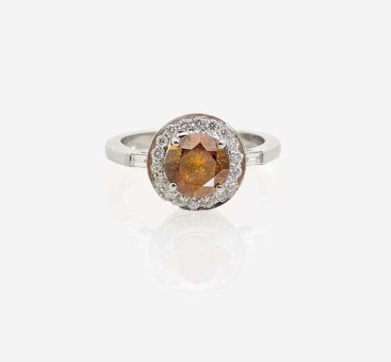 RING WITH AN ORANGE BRILLIANT - photo 1