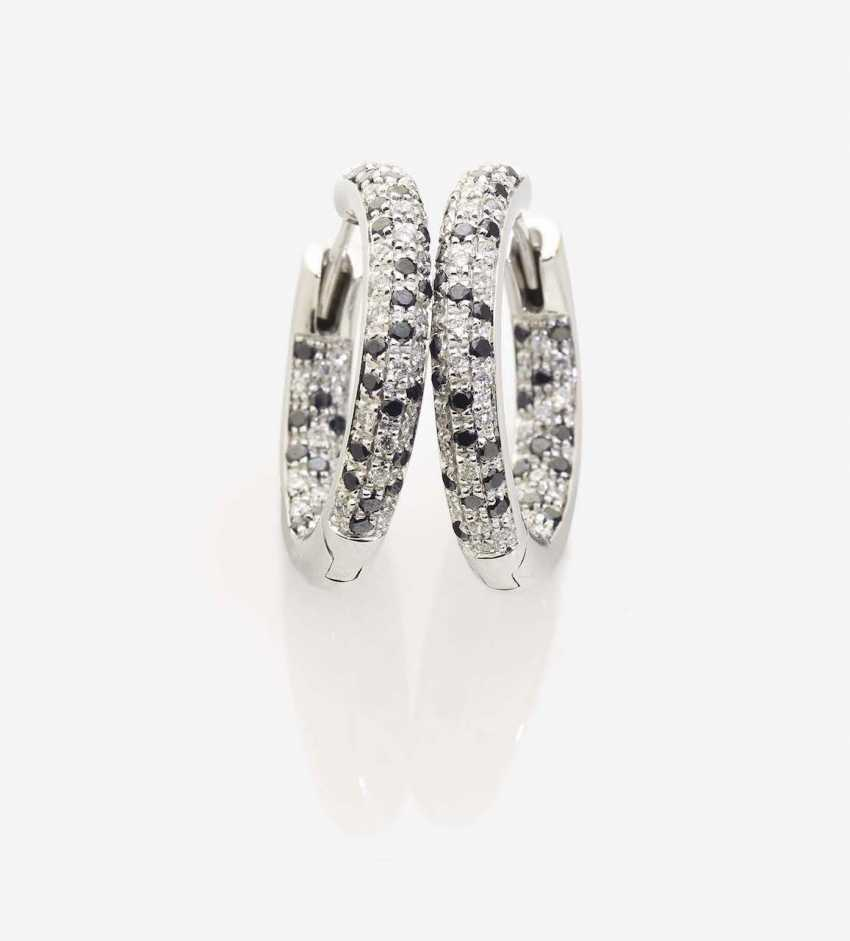 A PAIR of stud pin earrings EMBELLISHED WITH White AND BLACK BRILLIANT-cut diamonds - photo 1