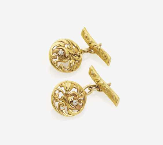 A PAIR OF CUFFLINKS EMBELLISHED WITH DIAMONDS - photo 1