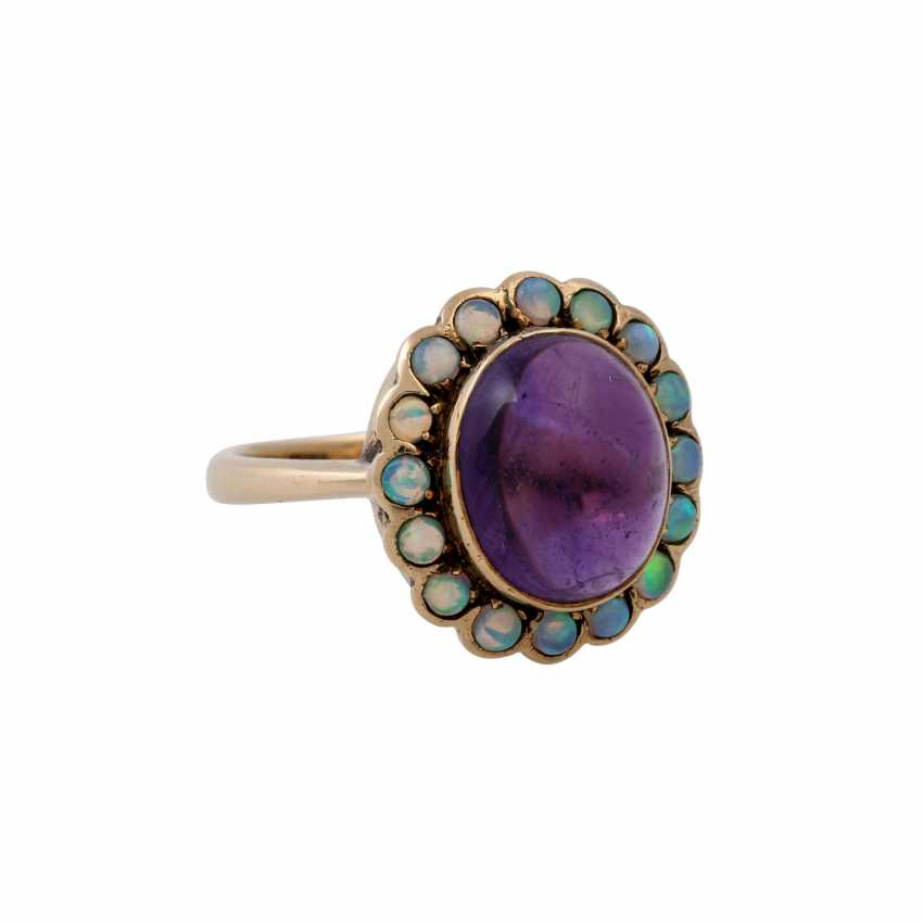 Ring with oval amethyst cabochon and small. Opals, - photo 1