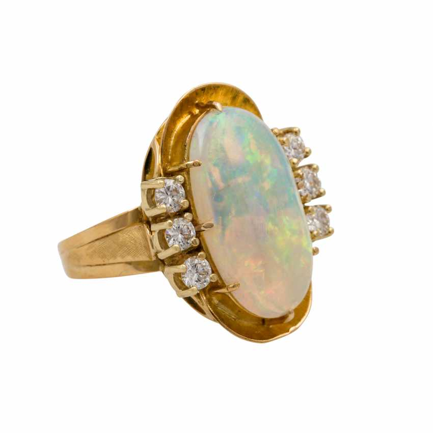 Ring with oval opal approx. 4.2 ct and 6 brilliant-cut diamonds totaling approx. 0.65 ct, - photo 1