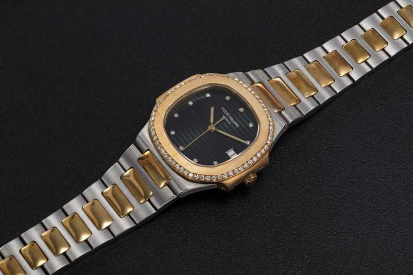 PATEK PHILIPPE, REF. 3900/2, A STEEL AND GOLD NAUTILUS WITH A DIAMOND-SET BEZEL - photo 1