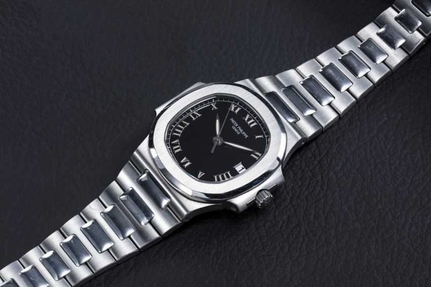 PATEK PHILIPPE, REF. 3800/1A-001, A STEEL NAUTILUS WITH BLACK DIAL AND ROMAN NUMERALS - photo 1