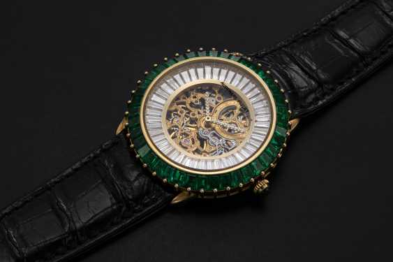 AUDEMARS PIGUET, A GENTS GOLD WRISTWATCH SET WITH EMERALDS, DIAMONDS AND SKELETONISED DIAL, ENGRAVED NO. 1 - photo 1