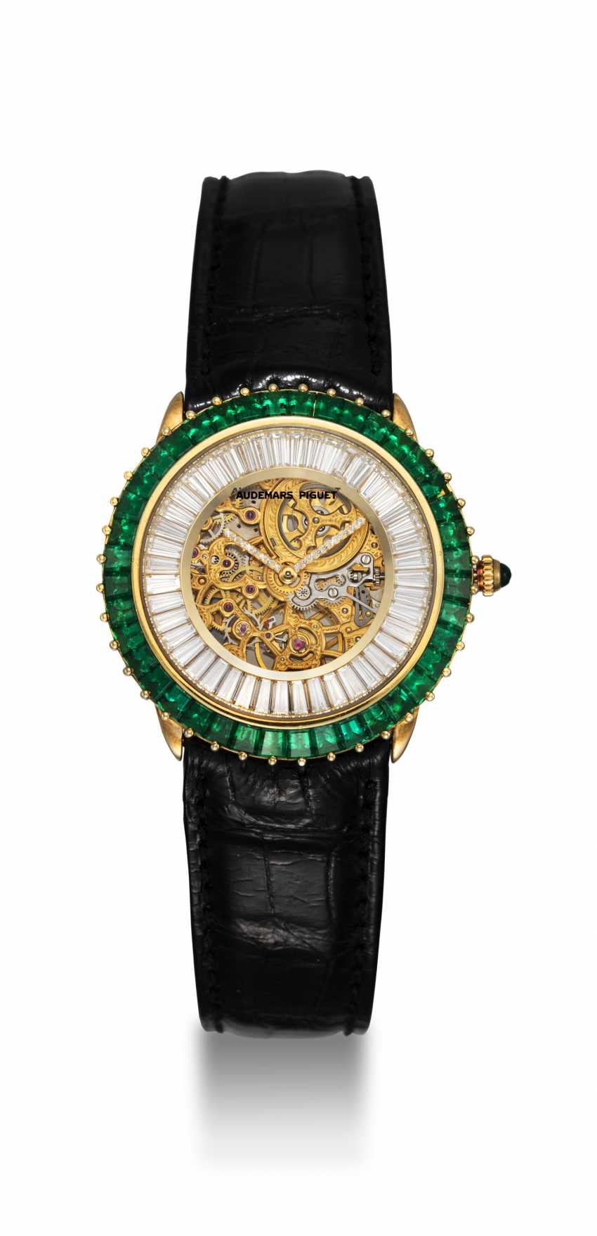 AUDEMARS PIGUET, A GENTS GOLD WRISTWATCH SET WITH EMERALDS, DIAMONDS AND SKELETONISED DIAL, ENGRAVED NO. 1 - photo 3